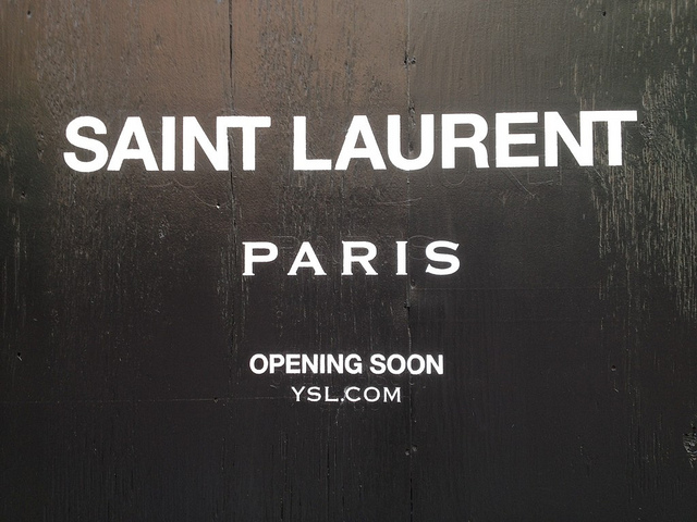 "What font is used for the word ""Paris"" in the new Saint Laurent Paris logo?"